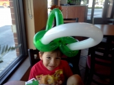 green and white hat balloon sculpture